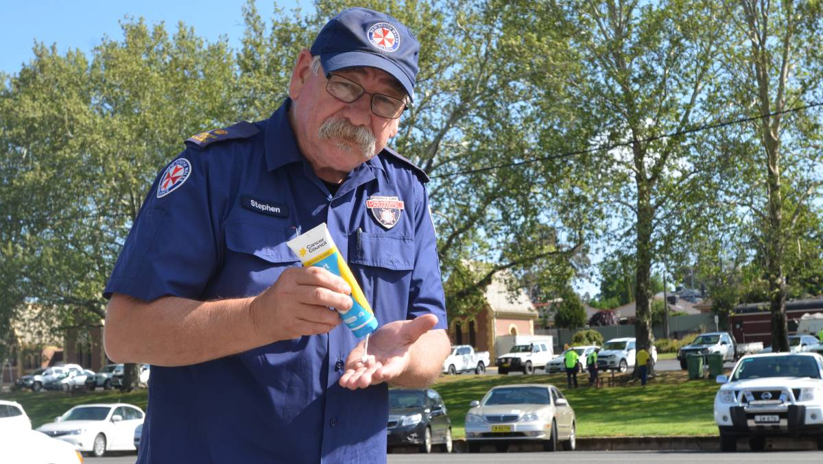 Ambulance Inspector Stephen Pollard, pictured promoting sun safety before a recent summer, reached 45 years service last month. Photo: file